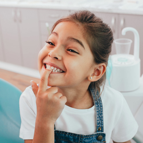 adorable-little-girl-shows-toothy-smile