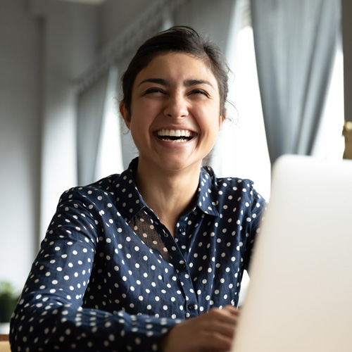 cheerful-girl-laughing-at-laptop
