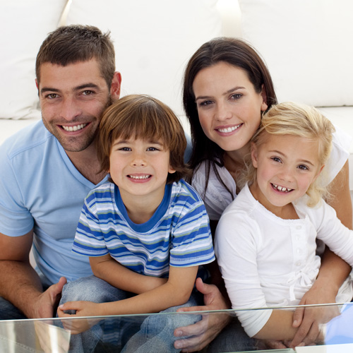 happy-family-smiling-in-living-room