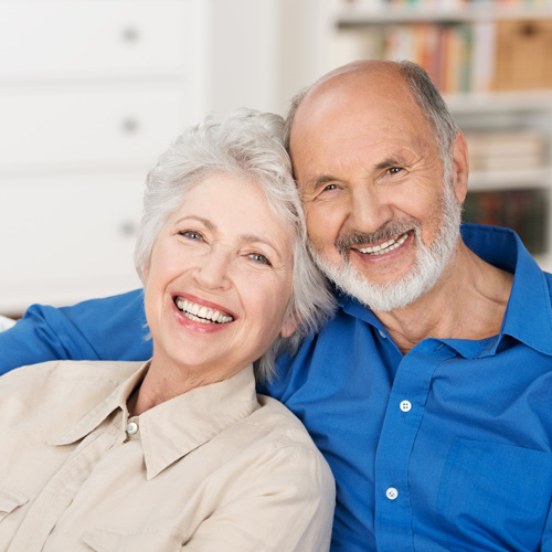 senior-couple-smiling-and-laughing