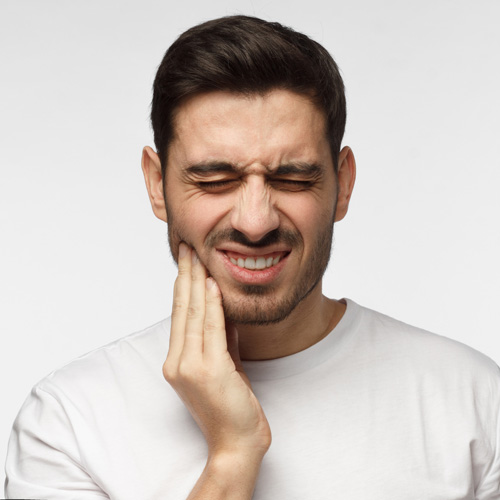 young-man-suffering-dental-emergency-with-pain